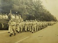 Major Mitsuyoshi Fukuda leading postwar review of battalion.