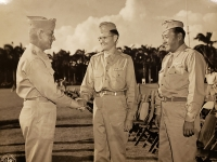 31 July 1947, Ft. Shafter, Oahu, T.H.  Lt. General John E. Hull congratulating Lt. Colonel Harry Albright of the Honolulu Advertiser, Commanding Officer of the 442nd Infantry Regiment upon its reactivation into the regular Army Reserve after the reactivation ceremony held at Ft. Shafter. Looking on is Major Mitsuyoshi Fukuda, Commanding Officer, 100th Infantry Battalion.