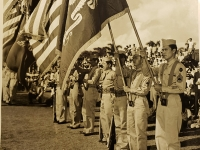 31 July 1947, Ft. Shafter, Oahu, T.H. Color bearers of the 442nd Infantry Regiment and the 100th Infantry Battalion stands at attention as troops pass in review during cermonies reactivating the famed fighting unit into the regular Army Reserve Corps held at Fort Shafter.