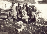 Men hunkered down on the side of Monte Cassino [Courtesy of Ed Ikuma]