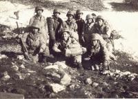 Men hunkered down on the side of Monte Cassino [Courtesy of Ed Ikuma]