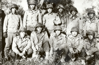 Men of Co. E, 100th Inf. Bn., Nov. 1943, shortly after first crossing of the Volturno River, Italy Back row, left to right: Yozo Yamamoto, Henry Shiyama, Yoshikatsu Matsumoto, Kaoru Yamamoto, Charles J. Okimoto, Takeshi Lefty Kimura. Front row, left to right: Kunio Fujimoto, Susumu Kunishige, Raymond Yokoyama, Katsumi Jinnohara, Kaoru Yonezawa. [U.S. Army Signal Corps]