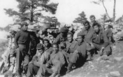 """March 1945 - OP2 Mt. Grammondo, France """"A"""" Co. guys - L to R Charles Hino, Joe Ando, Ken Akagi, Saburo Tsuchiyama, Ed Yamamoto, Toke Yoshihashi, Noah Kawaguchi, Ben Chikami, Tad Arimura and Sadao Ikoma. [Courtesy of Sam Fujikawa]"""