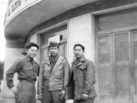 Tom shibao, George Mizuno, and Kow Ito stand in front of an Italian store. [Courtesy of Bernard Akamine]