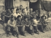 Back row:  Lt. Ambrose, Kazuo Sato, Stanley Kanno/2nd row:  Sam Setsu, Isami Hara, Conrad Kurahara, Kow Ito, Richard Murashige, Harry Fukushima/Front row:  Tom Matsumoto, ?, Toshio Funai, Paul Nishimuta, Ned Minamoto, Frank Wada, Mitsugu Eto - taken in Tombolo, Italy, Jul/Aug 1946, just before unit left for USA [Courtesy of Bernard Akamine]