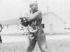 Lt. Tanaka at bat. Old camp. [Courtesy of Bert Hamakado]
