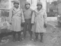 Three soldiers pose for a photo in their winter gear, 1944. [Courtesy of Mary Hamasaki]