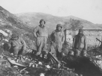 Soldiers take some down time on a Cassino hillside, Italy, 1944. [Courtesy of Mary Hamasaki]