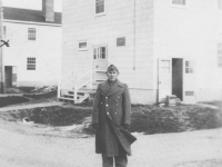 Tadayoshi Hamasaki stands in front of the barracks at Camp McCoy, Wisconsin, 1942. [Courtesy of Mary Hamasaki]