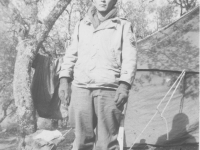 Tadayoshi Hamasaki stands in front of his tent. [Courtesy of Mary Hamasaki]