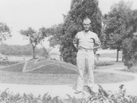 Tadayoshi Hamasaki poses in front of a garden in Wisconsin, 1942. [Courtesy of Mary Hamasaki]