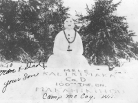 Mele Kalikimaka snowman at Camp McCoy, Wisconsin, 1942. [Courtesy of Mary Hamasaki]