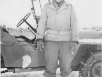 Tadayoshi Hamasaki in front of his jeep in Wisconsin, November 27, 1942. [Courtesy of Mary Hamasaki]