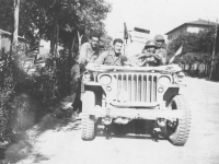 Tadayoshi Hamasaki and friends drive a jeep through an Italian town. [Courtesy of Mary Hamasaki]