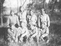 Eight soldiers pose for a group photo. [Courtesy of Mary Hamasaki]