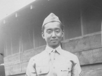 Kwon and Kuhaki (in background on steps) Sargeant Harada (posing in uniform) Jan. 1941.   [Courtesy of Mike Harada]