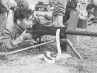 Kawasaki on the machine gun [Courtesy of Kenneth Higa]