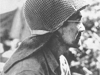 Neither whiskers nor mud could hide the pride of Genkichi Akamine who fought as a sniper for the 100th BN.   [U.S. Army Signal Corps]