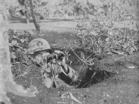 Lt. John Ko of the 100th Bn. Searches for enemy positions. [Courtesy of U.S. Army Signal Corps]