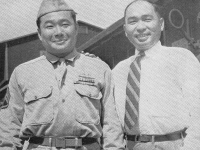 Well known University of Hawaii Agricultural Dept. head, Baron Goto greets his younger brother, s/sgt. Masaichi Goto. Da War All Pau!!!   [U.S. Army Signal Corps]
