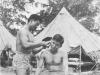George T. Inouye getting a haircut. [Courtesy of Colleen Iwata]