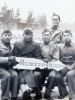 "5 soldiers at pier holding sign ""Rookery Road"".  Kazuo Yamane seated on the far right.  [Courtesy of James Nogawa]"