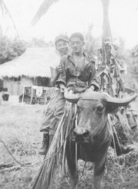 Tom Matsumura and a friend ride a carabao in the Philippines. [Courtesy of Florence Matsumura]