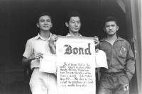 Members of the VVV with their pledge to buy war bonds monthly from left: George Tokuyama, Henry Oyasato, and Yoshihara Mikami [Courtesy of Ted Tsukiyama Papers, University of Hawaii at Manoa Library]