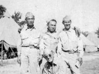 (July 20, 1942) Cpl. Walter Moriguchi, Pfc. Tanoue, Cpl. Yozo Yamamoto, & Sgt. Kawakami.  Eugene Kawakami is crouched in the front.  [Courtesy of Joanne Kai]