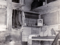 (August 30, 1942) My bunk is next to me inside of tent.  Wooden boards are for protection when it snows and rains.  Eugene Kawakami inside of his tent at Camp McCoy, Wisconsin, while he waits for his laundry to dry.  [Courtesy of Joanne Kai]