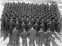 "(December 11, 1942) 100th Infantry Battalion, Company ""A"", in Camp McCoy, Wisconsin.  Eugene Kawakami is in the second row, third from the right. [Courtesy of Joanne Kai]"
