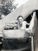 "(August 30, 1942) ""My bunk is next to me inside of tent. Wooden boards are for protection when it snows and rains."" Eugene Kawakami inside of his tent at Camp McCoy, Wisconsin, while he waits for his laundry to dry.  [Courtesy of Joanne Kai]"