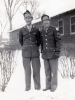 "(December 25, 1942) ""Sgt. Yoshiura and S/Sgt. Kawakami at Camp Savage, Minnesota"". Eugene Kawakami (right), Kenneth Yoshiura (left), and a few others went to visit their friends who transferred from Company ""A"" to the MIS. They enjoyed a nice Christmas dinner with them at their training site, Camp Savage.   [Courtesy of Joanne Kai]"