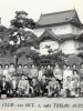"(October 02, 1962) Members of the 100th Infantry Battalion Veteran's Club, ""Club 100"", in front of the Imperial Palace in Tokyo, Japan. Eugene Kawakami was the leader for ""Group I"" on this Japan Trip, comprised of Company ""A"" and Company ""C"" veterans and wives. Eugene is pictured in the front row, on the far left.  [Courtesy of Joanne Kai]"