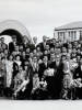 "(October 1962) Members of the 100th Infantry Battalion Veteran's Club, ""Club 100"", at the Hiroshima Peace Memorial. This was the first time the club organized a trip to Japan. Eugene Kawakami is in the middle-right of the front row, wearing a black suit with leis.  [Courtesy of Joanne Kai]"