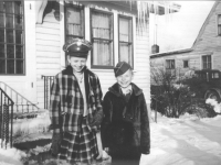 Corrine and Kay Falke wearing Army covers while at Aunt Vi's and Uncle Bill's house in LaCrosse, Wisconsin, winter 1942. [Courtesy of Mieko Muroshige]