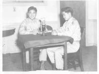 Conrad (facing camera) and Laverne Kurahara tell their story during a radio segment. [Courtesy of Jane Kurahara]