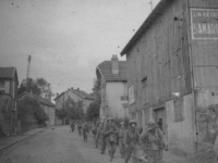 Soldiers march through an Italian town. [Courtesy of Jane Kurahara]