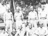 Taken at Wisconsin Rapids. Standling Left to Right. Sgt. Yamada (married), M. Okazaki, Akimoto, Corp. Tomai; Sitting Left to Right: Sgt. Yamada's Nephew & Niece. Yours Truly, Joe Takata (Married) Hide Yamashita (married) Yozo Yamanioto (married). [Courtesy of Leslie Taniyama]