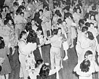 Internee women from Jerome and Rohwer Relocation Centers attend a dance with 442nd soldiers at Camp Shelby, Mississippi [Office of War Information, National Archives, Record Group 208-MO]