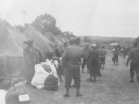 Moving out to ….New Camp McCoy.  Taken Sept.  24, 1942 at Old Camp McCoy.  Another picture of group ready to leave for New Camp McCoy.  [Courtesy of Jan Nadamoto]