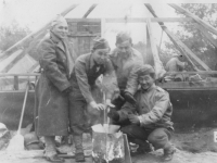Haya, PeeWee, Woppy.  Taken Sept. 24, 1942 at Old Camp McCoy,on moving day.  Another group picture. Constantly 37 degrees  cold and snow.  L To R Haruo Hayakawa, George Hirata, Stanley Imamura and myself.  Note everybody, except one, with gloves (woolen ones) on.   It snowed snowflakes for the first time that afternoon.  [Courtesy of Jan Nadamoto]