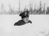 Snow Pics all taken at New Camp McCoy, Wisconsin.  Nov. 29, 1942 Isn't the snow dep though.  The snow on the foreground shows it, doesn't it.  The reason I'm most way down is because I'm lying down in a small gulch right along the roadside.  [Courtesy of Jan Nadamoto]