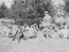 """Snap of our platoon taking a """"break"""" or rest period during drill hours at drill field at New Camp McCoy.  [Courtesy of Jan Nadamoto]"""