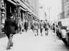 Strolling down street in St. Paul, Minn.  I'm in the middle. Oct. 3, 1942.  [Courtesy of Jan Nadamoto]