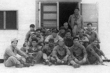 Cat Island and Ship Island Gang, Mississippi, 1942, Bottom row, L to R: William Takaezu, Tokuji Ono, James Komatsu, Fred Kanemura, Koyei Matsumoto, Yasuo Takata. Middle row,  L to R: Unknown, Robert Takashige (with hat), Seiji Tanigawa, John Kihara, Yukio Yokota (with arm on Kihara's shoulder). Top row, L to R:  Seiei Okuma, Takeshi Tanaka (arms around man in front of him), unknown, Masao Hatanaka, Katsumi Maeda, Ray Nosaka, Robert Goshima (standing). [Courtesy of Raymond Nosaka]