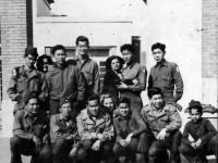 """Co. """"B"""" Boys in Italy Bottom Left to right: Soichi Harada, Sonny Kane, ?, ?, James Mizuno, Italian boy.  Back row, left to right: Paul Akama, Italian woman, Takashi Sandow, Toshio Santoki, Italian Woman, ?, Takuma Honke [Courtesy of Robert Arakaki]"""