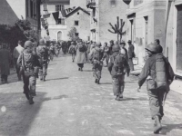 Soldiers Marching through Italian Town. [Courtesy of Fumie Hamamura]
