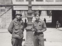 Lawrence Iwamoto and Tatsuo Suzuki pose near a street sign in Novi Ligure, Italy. [Courtesy of Fumie Hamamura]