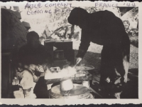 Able Company cooking food in France, 1944. [Courtesy of Fumie Hamamura]